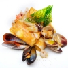 Crespelle mit Meeresfrüchten